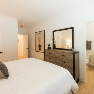 Furnished bedroom and bathroom in The Concord apartments